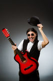 Man wearing sunglasses and playing guitar Stock Photography