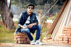 Man Wearing Sunglasses Sitting on the Concrete Bricks Royalty Free Stock Photos
