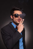 Man wearing sunglasses and smoking Royalty Free Stock Photo