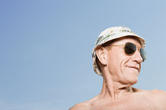 Man wearing sunhat and sunglasses Stock Image