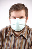 Man wearing a surgical mask royalty free stock photo