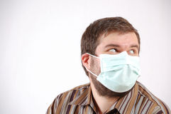 Man wearing a surgical mask Stock Photography