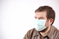 Man wearing a surgical mask Stock Images