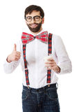 Man wearing suspenders with glass of milk. royalty free stock images
