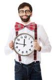Man wearing suspenders holding big clock. Royalty Free Stock Photos