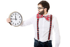 Man wearing suspenders holding big clock. stock photography