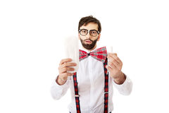 Man wearing suspenders holding menstruation pad. Stock Photos
