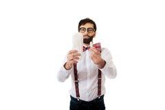 Man wearing suspenders holding menstruation pad. Stock Photo