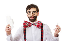 Man wearing suspenders holding menstruation pad. stock photo