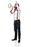 Man wearing suspenders with megaphone. Funny man wearing suspenders shouting with megaphone Royalty Free Stock Image
