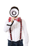 Man wearing suspenders with megaphone. Funny man wearing suspenders shouting with megaphone Royalty Free Stock Images