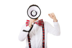 Man wearing suspenders with megaphone. Stock Photo
