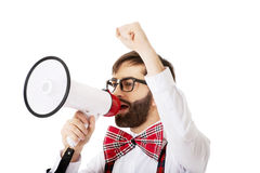 Man wearing suspenders with megaphone. Funny man wearing suspenders shouting with megaphone Royalty Free Stock Photos