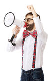 Man wearing suspenders with megaphone. Funny man wearing suspenders shouting with megaphone Stock Images
