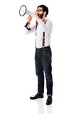 Man wearing suspenders with megaphone. Funny man wearing suspenders shouting with megaphone Stock Photo