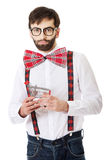 Man wearing suspenders with small shopping basket. Stock Photo