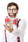 Man wearing suspenders with small shopping basket. Royalty Free Stock Images