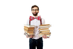 Man wearing suspenders with stack of books. Royalty Free Stock Photo