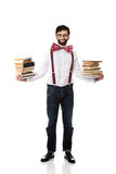 Man wearing suspenders with stack of books. Royalty Free Stock Images