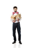 Man wearing suspenders with stack of books. Stock Images