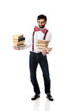 Man wearing suspenders with stack of books. royalty free stock image