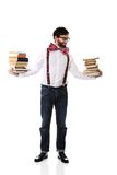 Man wearing suspenders with stack of books. Stock Photography