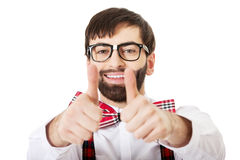 Man wearing suspenders with thumbs up. Royalty Free Stock Image