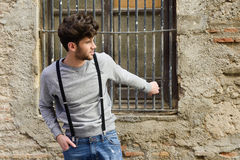 Man wearing suspenders in urban background Stock Images