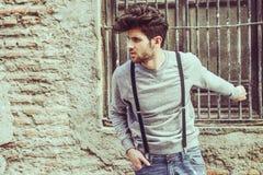 Man wearing suspenders in urban background Stock Photo