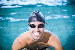 Man wearing swimming goggles Stock Images