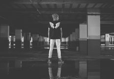 Man Wearing T Shirt and Pants Standing at the Parking Lot in Grayscale Royalty Free Stock Photography