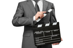 Man wearing tie and costume holding clapper board. Man wearing tie and costume holding movie clapper board isolated on white Stock Photography