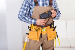 Man Wearing Tool Belt At Home Royalty Free Stock Photo