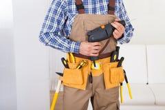 Man Wearing Tool Belt At Home Royalty Free Stock Photo