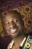 Man wearing traditional African clothing. Portrait of smiling mid-adult African-American man Royalty Free Stock Photography