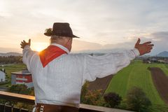 Man wearing traditional clothing greeting a new day Stock Photo