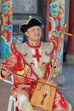 Man wearing traditional costume performs music with morin khuur - national musical instrument in Ulaanbaatar, Mongolia. Royalty Free Stock Photos