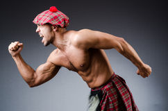 Man wearing traditional scottish clothing Stock Images