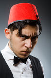 Man wearing traditional turkish hat Stock Photo