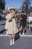 Man wearing a trench coat playing the trombone at the Doo Dah Parade, Pasadena, California Royalty Free Stock Photos