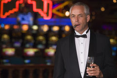 Man wearing tuxedo in casino Royalty Free Stock Images