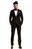 Man Wearing Tuxedo Standing With Hands In Pockets Stock Photography