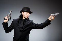 Man wearing vintage. Hat with gun Stock Image