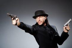 Man wearing vintage. Hat with gun Stock Photos