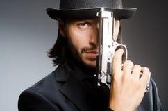 Man wearing vintage. Hat with gun Royalty Free Stock Photos