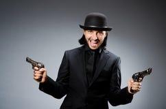Man wearing vintage. Hat with gun Royalty Free Stock Photography