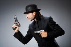 Man wearing vintage. Hat with gun Stock Photo