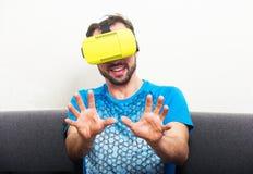 Man wearing virtual reality 3D glasses. Man wearing virtual reality 3D glasses lives in a virtual world Royalty Free Stock Photos