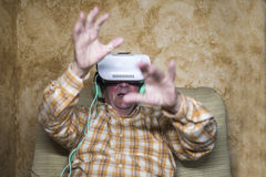 Man wearing Virtual Reality Glasses Royalty Free Stock Image