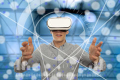 Man wearing virtual reality glasses Stock Photos